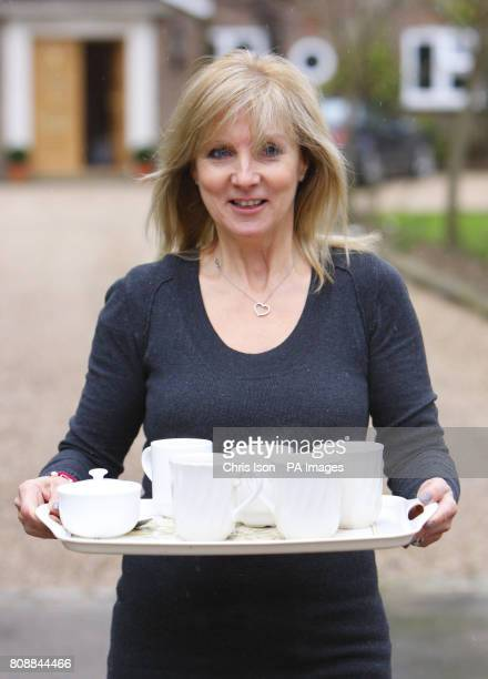 Julia Keys wife of former Sky Sports presenter Richard Keys brings a tray of tea to the media waiting outside her Surrey home