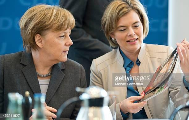 Julia Kloeckner head of CDU in RhinelandPalatinate shows German Chancellor Angela Merkel a magazine cover prior a meeting of CDU Party Board in CDU...