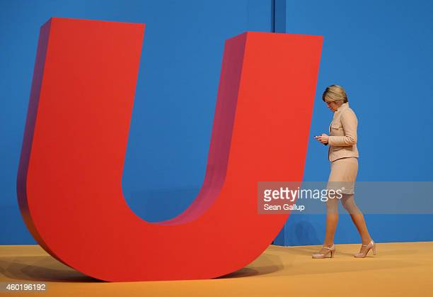 Julia Kloeckner head of the German Christian Democrats in RhinelandPalatinate walks past the CDU logo as she attends the CDU annual party congress on...