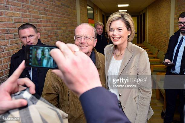 Julia Kloeckner lead candidate for the German Christian Democrats in RhinelandPalatinate state elections takes a photo with and old man at a polling...