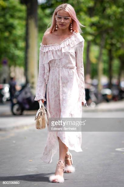 Julia Kuczynska Maffashion wears an off shoulder pink lace dress pink glasses and pink fur shoes outside the 22/4 Hommes show during Paris Fashion...