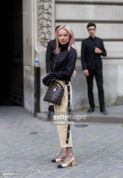 Julia Kuczynska wearing beige cropped pants Chanel shoes net tights outside Dior Homme during Paris Fashion Week Menswear Spring/Summer 2018 Day Four...