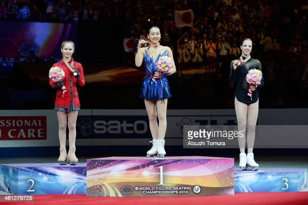 Julia Lipnitskaia of Russia Mao Asada of Japan and Carolina Kostner of Italy pose with medal in the victory ceremony during ISU World Figure Skating...
