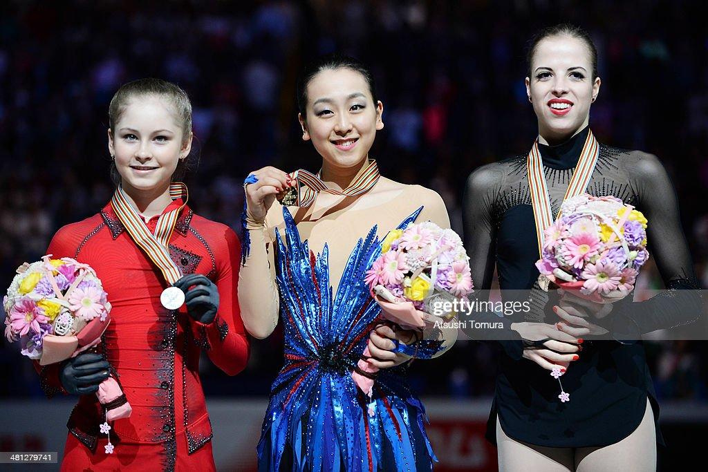 Julia Lipnitskaia (Silver) of Russia, Mao Asada (Gold) of Japan and Carolina Kostner (Bronze) of Italy pose with medal in the victory ceremony during ISU World Figure Skating Championships at Saitama Super Arena on March 29, 2014 in Saitama, Japan.