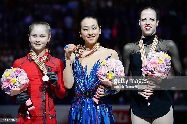 Julia Lipnitskaia of Russia Mao Asada of Japan and Carolina Kostner of Italy pose with medal in the victory ceremony during ISU World Figure Skating...