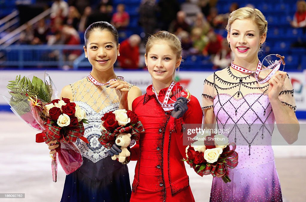 Julia Lipnitskaia of Russia wins the gold medal (centre) Akiko Suzuki of Japan wins silver (left) and Gracie Gold of the United States takes the silver medal in the ladies free program on day two at the ISU GP 2013 Skate Canada International at Harbour Station on October 26, 2013 in Saint John, New Brunswick, Canada.