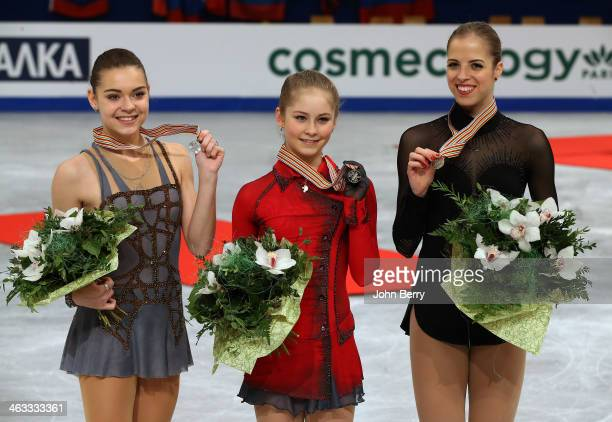 Julia Lipnitskaia of Russia wins the gold medal in front of silver medal Adelina Sotnikova of Russia and bronze medal Carolina Kostner of Italy in...
