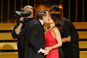 Julia LouisDreyfus and Bryan Cranston onstage during the 66th Annual Primetime Emmy Awards held at Nokia Theatre LA Live on August 25 2014 in Los...
