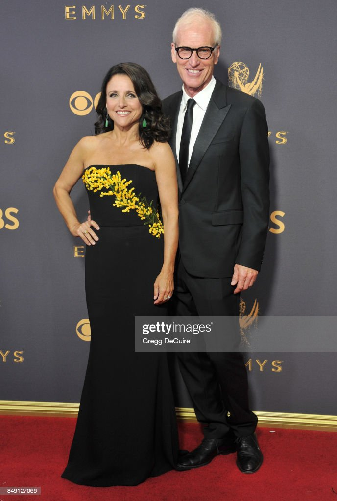 Julia Louis-Dreyfus and husband Brad Hall arrive at the 69th Annual Primetime Emmy Awards at Microsoft Theater on September 17, 2017 in Los Angeles, California.