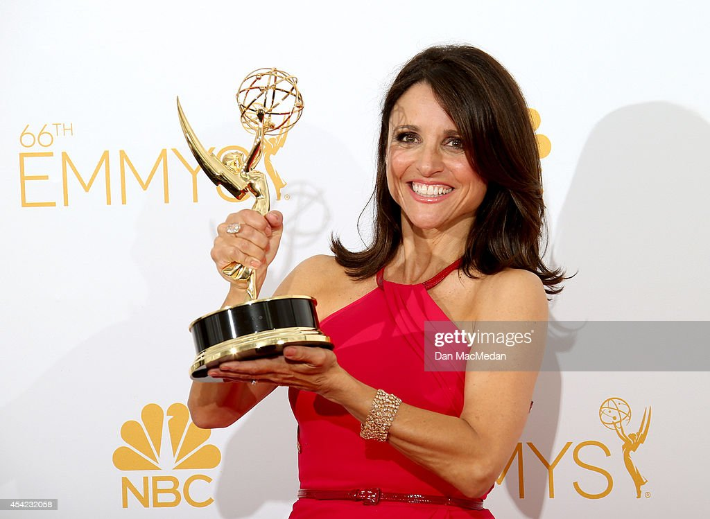 Julia Louis-Dreyfus poses in the photo room with her award for Outstanding Lead Actress in a Comedy Series for 'Veep' at Nokia Theatre L.A. Live on August 25, 2014 in Los Angeles, California.
