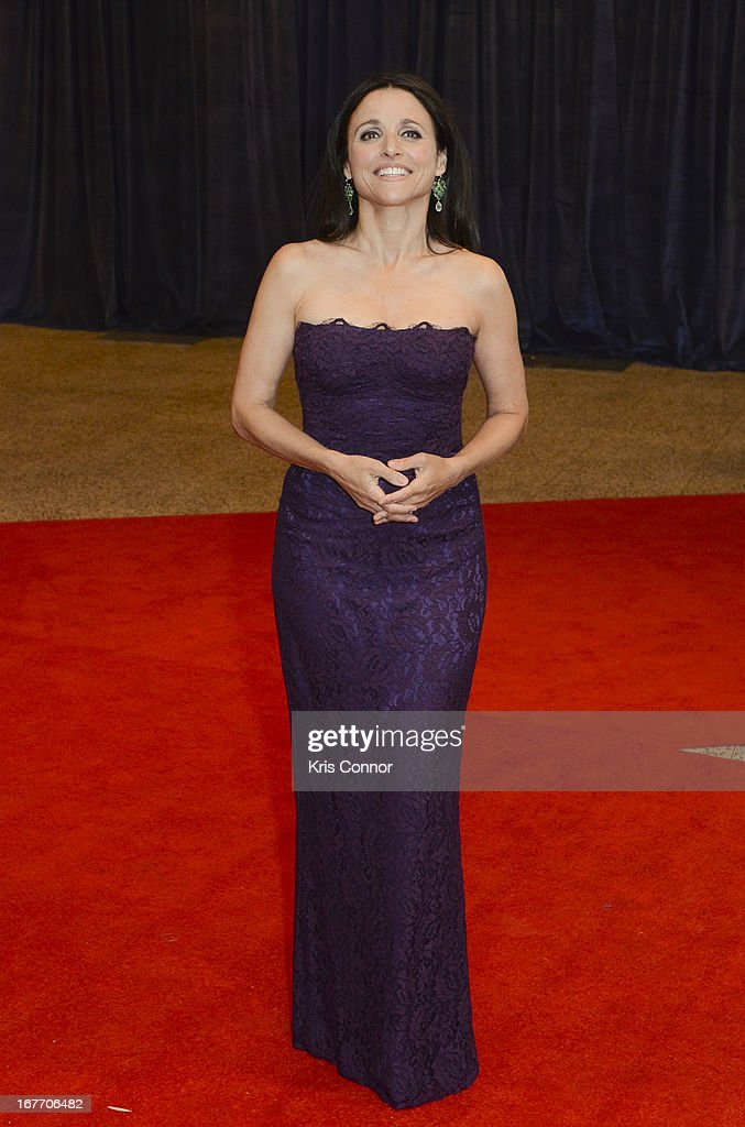 Julia Louis-Dreyfus poses on the red carpet during the White House Correspondents' Association Dinner at the Washington Hilton on April 27, 2013 in Washington, DC.