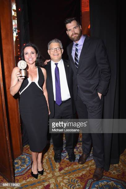 Julia LouisDreyfus Senator Al Franken and Timothy Simons pose with an award during The 76th Annual Peabody Awards Ceremony at Cipriani Wall Street on...