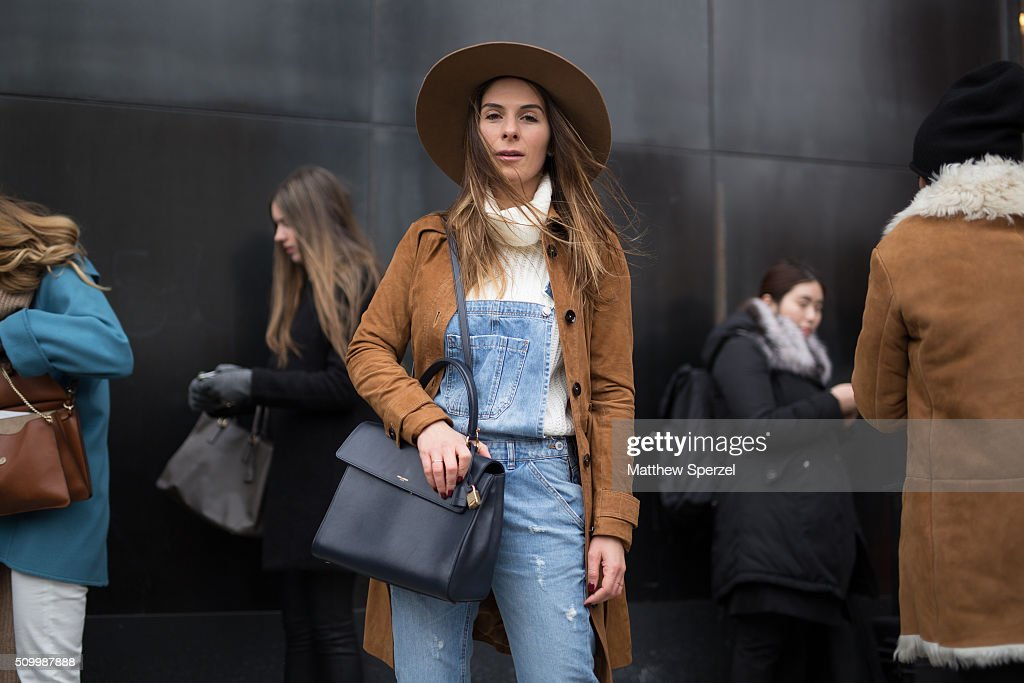 Julia Mateian is seen at Lacoste wearing Shop the 26th hat & shoes, Lamarck coat, YSL bag, and Zara overalls during New York Fashion Week: Women's Fall/Winter 2016 on February 13, 2016 in New York City.