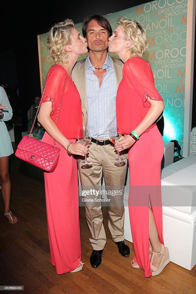 Julia Meise Marcus Schenkenberg and Nina Meise attend the New Faces Award Fashion 2014 on July 25 2014 in Duesseldorf Germany
