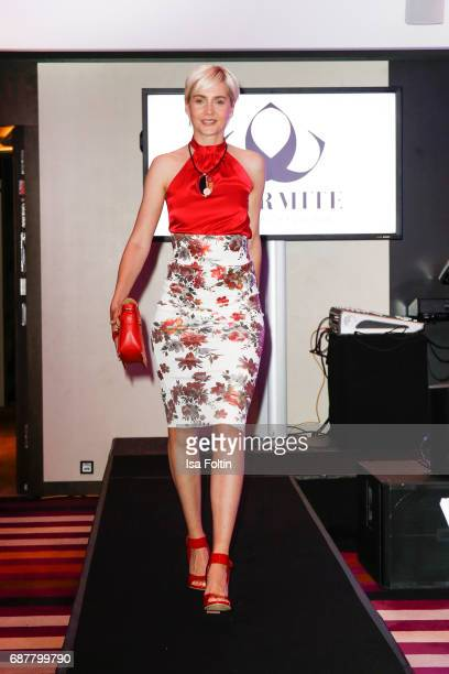 Julia Meise walks the runway during the Kempinski Fashion Dinner on May 23 2017 in Munich Germany