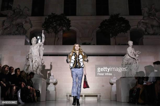 Julia Nobis general view walks the runway during the Louis Vuitton show as part of the Paris Fashion Week Womenswear Fall/Winter 2017/2018 on March 7...