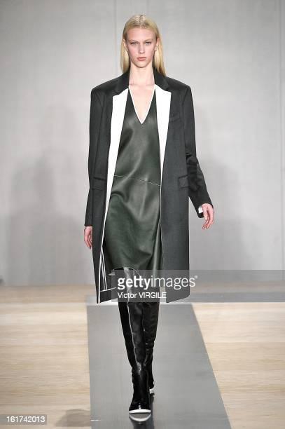 Julia Nobis walks the runway at the Reed Krakoff Ready to Wear Fall/Winter 20132014 fashion show during MercedesBenz Fashion Week on February 13 2013...