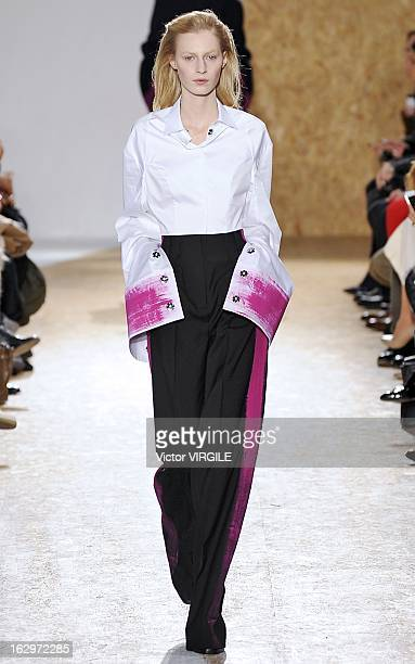 Julia Nobis walks the runway during the Maison Martin Margiela Fall/Winter 2013 ReadytoWear show as part of Paris Fashion Week at Gymnase Japy on...