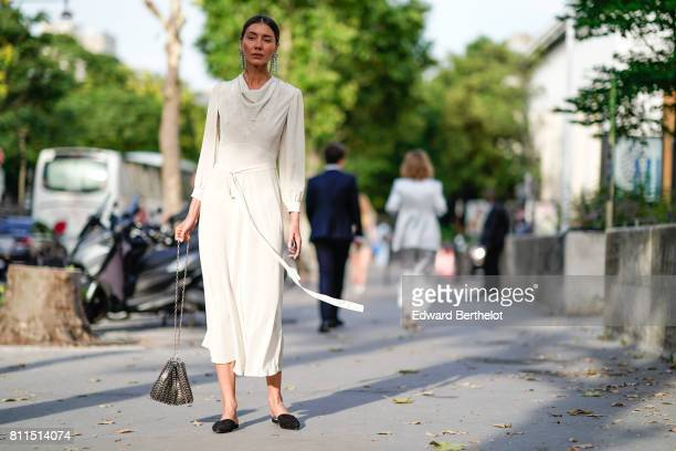 Julia Pelipas wears a white dress outside the launch party for Chanel's new perfume 'Gabrielle' during Paris Fashion Week Haute Couture Fall/Winter...