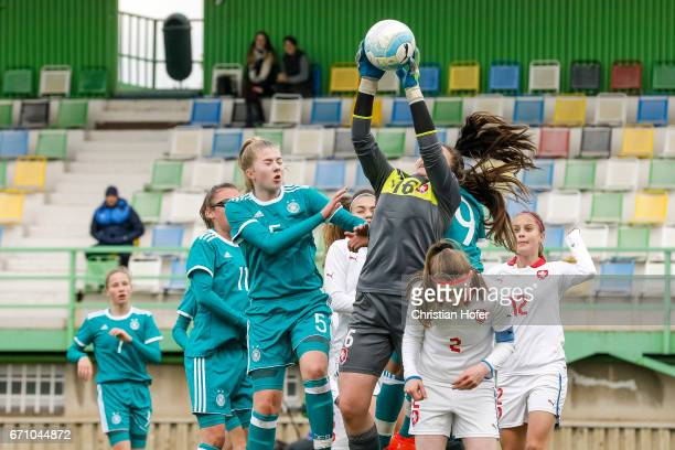 Julia Pollak and Lina Katharina Vianden of Germany compete for the ball in the air with goalkeeper Nikola Kucerova Klara Bazoutova and Aneta Sovakova...