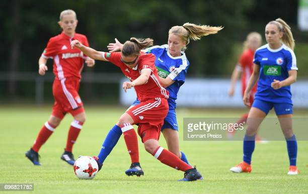 Julia Pollak of FC Bayern Muenchen challenges Marlene Mueller of 1 FFC Turbine Potsdam during the B Junior Girl's German Championship Final between...