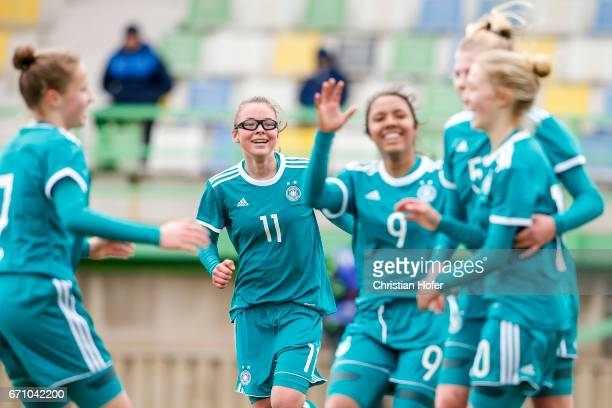 Julia Pollak of Germany and team mates celebrate after scoring during the Under 15 girls international friendly match between Czech Republic and...
