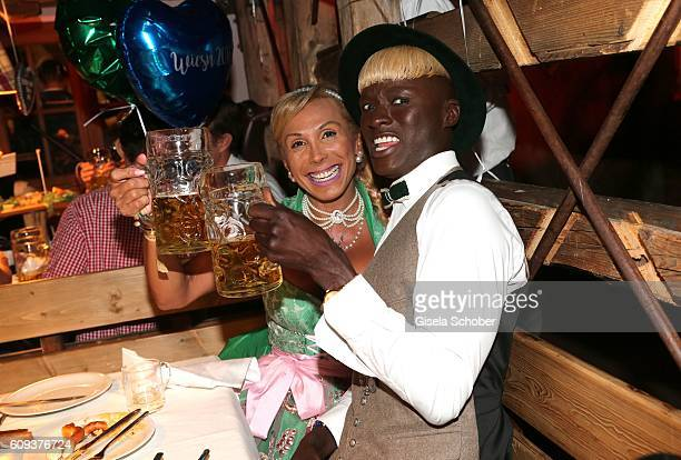 Julia Prillwitz and Papis Loveday during the Oktoberfest at Kaeferschaenke at Theresienwiese on September 20 2016 in Munich Germany