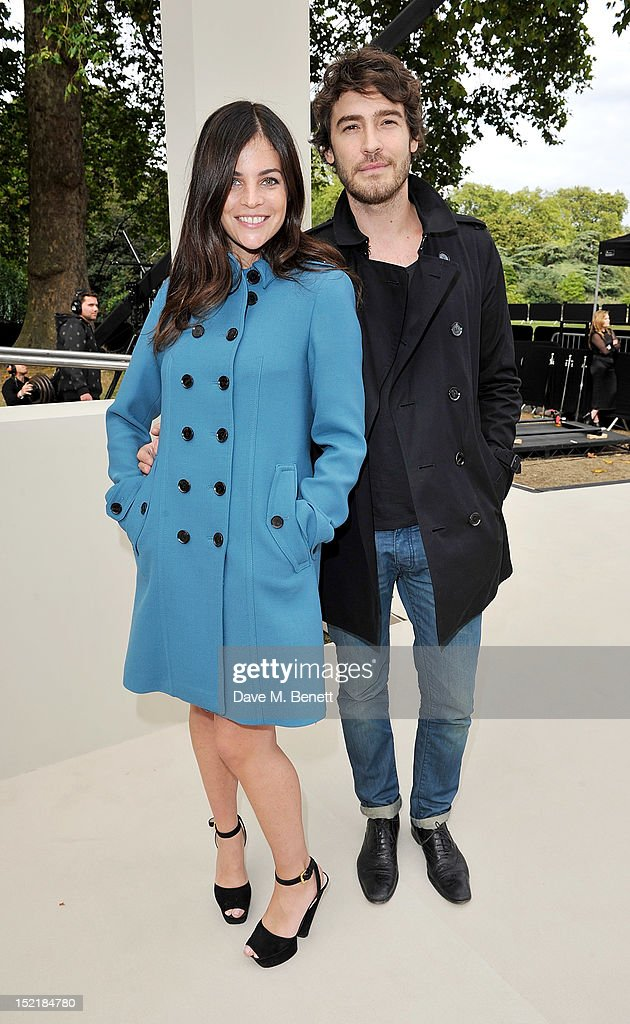 Julia Restoin Roitfeld (L) and Robert Konjic arrive at the Burberry Spring Summer 2013 Womenswear Show during London Fashion Week on September 17, 2012 in London, United Kingdom.