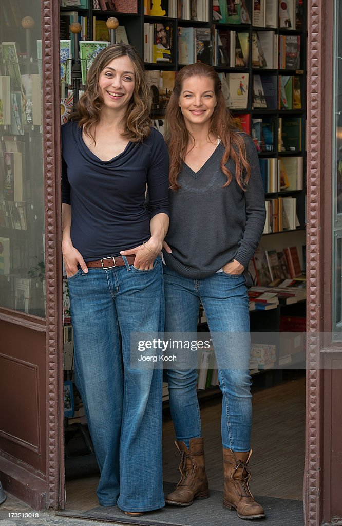Julia Richter and Yvonne Catterfeld attend the 'Cecelia Ahern' photocall at Glockenbach book store on July 10 2013 in Munich Germany