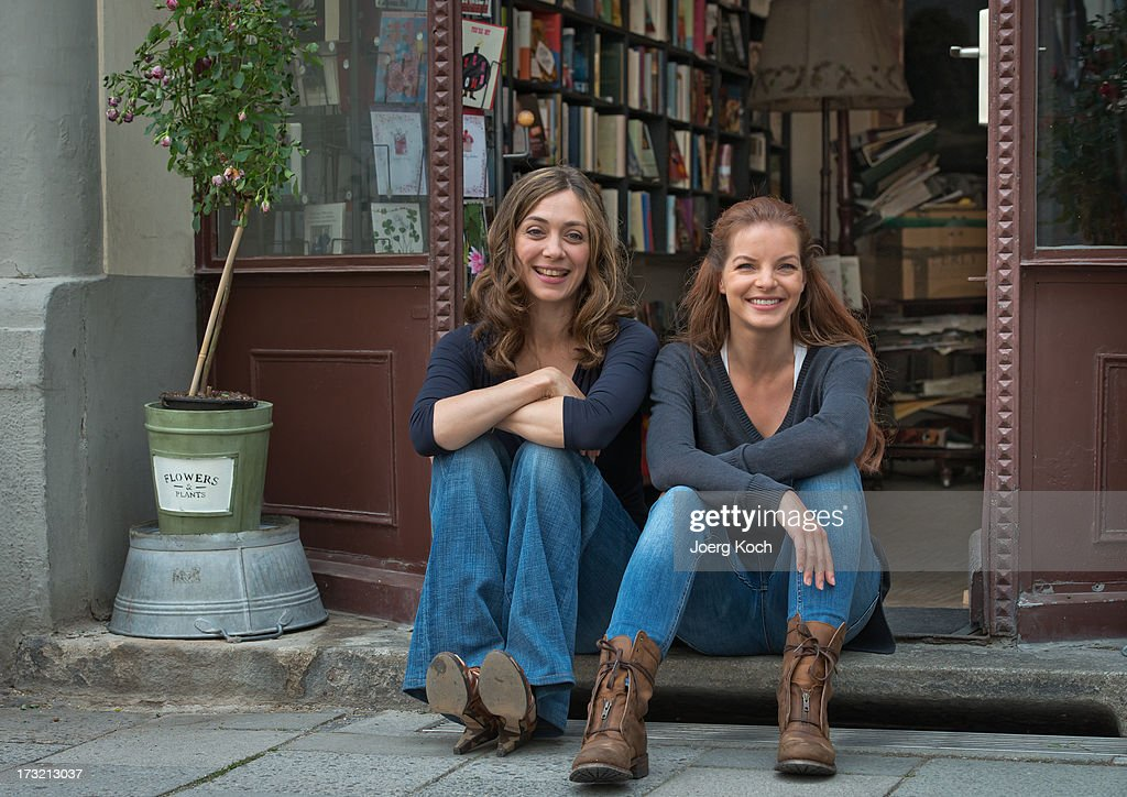 Julia Richter (L) and <a gi-track='captionPersonalityLinkClicked' href=/galleries/search?phrase=Yvonne+Catterfeld&family=editorial&specificpeople=228473 ng-click='$event.stopPropagation()'>Yvonne Catterfeld</a> (R) attend the 'Cecelia Ahern' photocall at Glockenbach book store on July 10, 2013 in Munich, Germany.