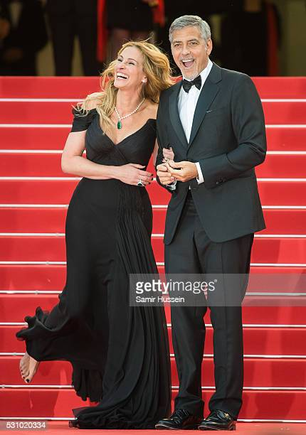 Julia Roberts and George Clooney attend the screening of 'Money Monster' at the annual 69th Cannes Film Festival at Palais des Festivals on May 12...
