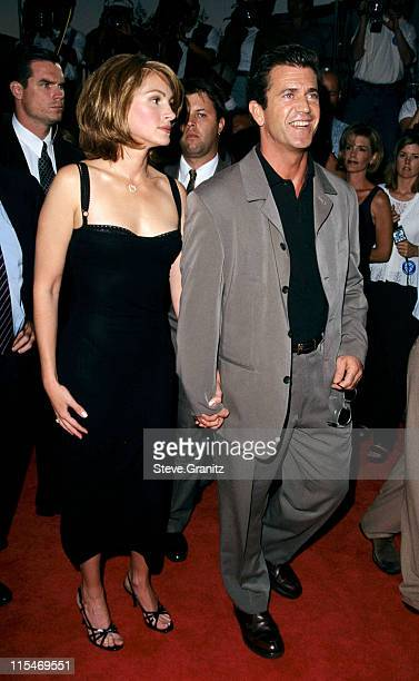 Julia Roberts and Mel Gibson during ''Conspiracy Theory'' Premiere at Mann Village Theatre in Westwood California United States