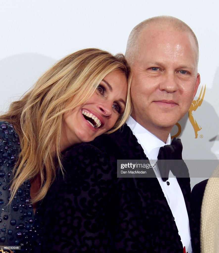 <a gi-track='captionPersonalityLinkClicked' href=/galleries/search?phrase=Julia+Roberts&family=editorial&specificpeople=202605 ng-click='$event.stopPropagation()'>Julia Roberts</a> and <a gi-track='captionPersonalityLinkClicked' href=/galleries/search?phrase=Ryan+Murphy+-+Writer+and+film+director&family=editorial&specificpeople=4530399 ng-click='$event.stopPropagation()'>Ryan Murphy</a> pose in the photo room with their award for Outstanding Television Movie for 'The Normal Heart' at Nokia Theatre L.A. Live on August 25, 2014 in Los Angeles, California.