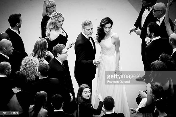 Julia Roberts George Clooney and his wife Amal Clooney attend the screening of 'Money Monster' at the annual 69th Cannes Film Festival at Palais des...