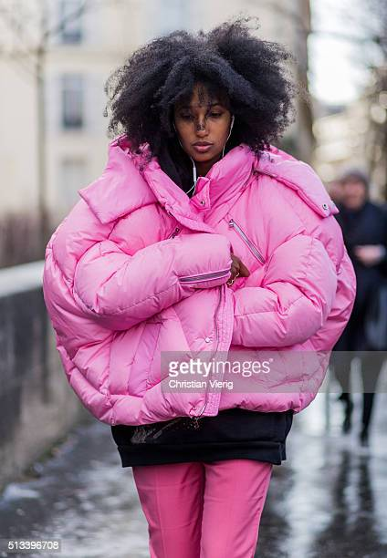 Julia Sarr Jamois wearing a huge pink feather down jacket and a black hoody pink pants outside Rochas during the Paris Fashion Week Womenswear...