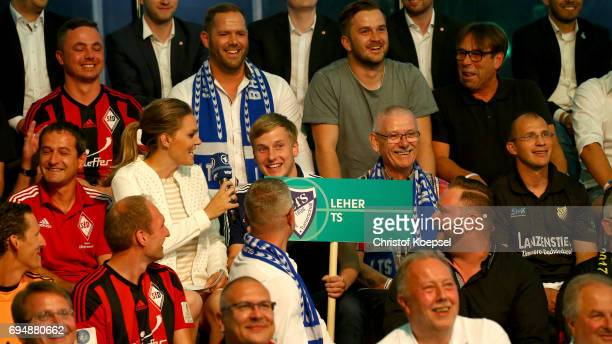 Julia Scharf reporter speaks to members of Leher TS after being chosen for the match against 1 FC Koeln during the DFB Cup Draw at Deutsches...