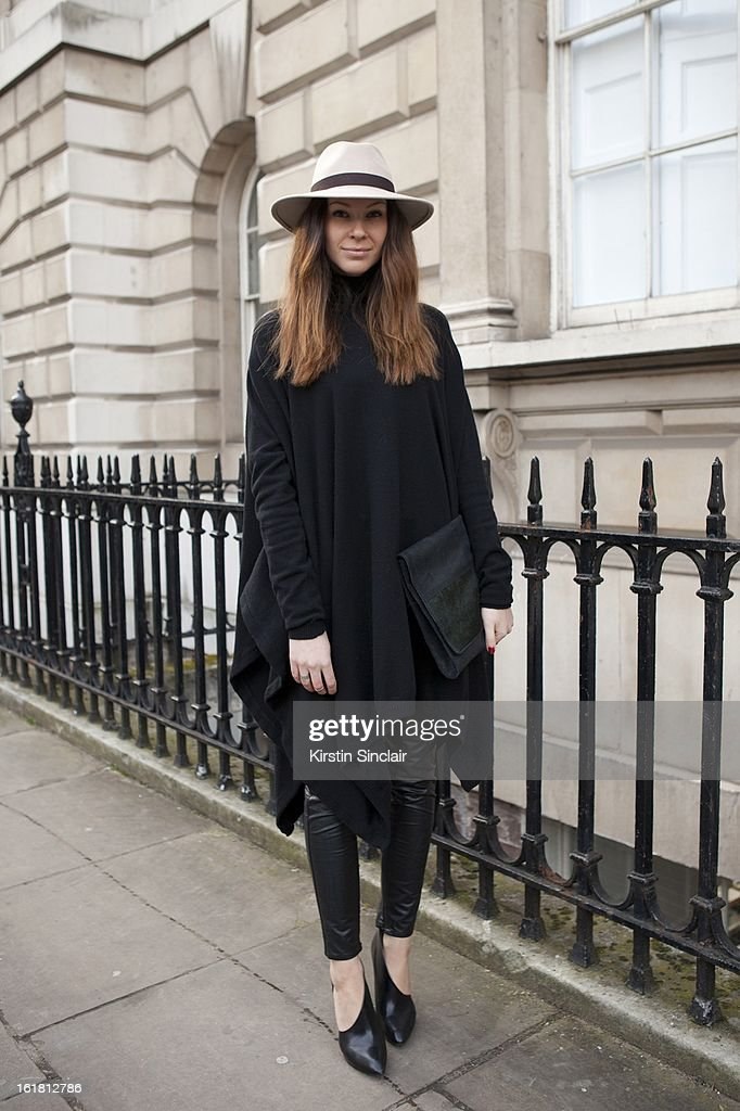 Julia Shutenko Elle fashion assistant wearing Reiss hat, All Saints top, Karl Lagerfeld trousers, Lanvin shoes, on day 2 of London Womens Fashion Week Autumn/Winter 2013 on February 16, 2013 in London, England.