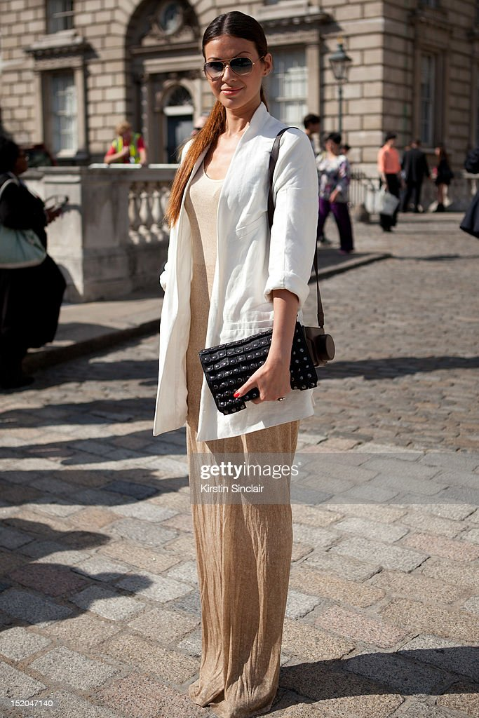 Julia Shutenko fashion intern at Elle wearing an Acne jacket, Zara dress and a Lanvin shoes and Ray Ban sunglasses on day 2 of London Fashion Week Spring/Summer 2013, at Somerset House on September 15, 2012 in London, England.