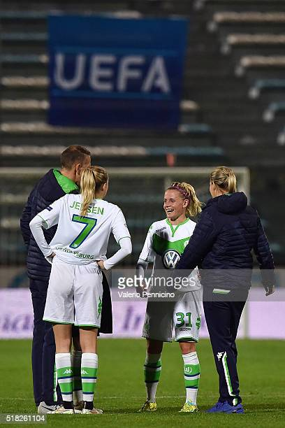 Julia Simic and Synne Jensen of Wolfsburg celebrate victory at the end of the UEFA Women's Champions League Quarter Final match between Brescia and...