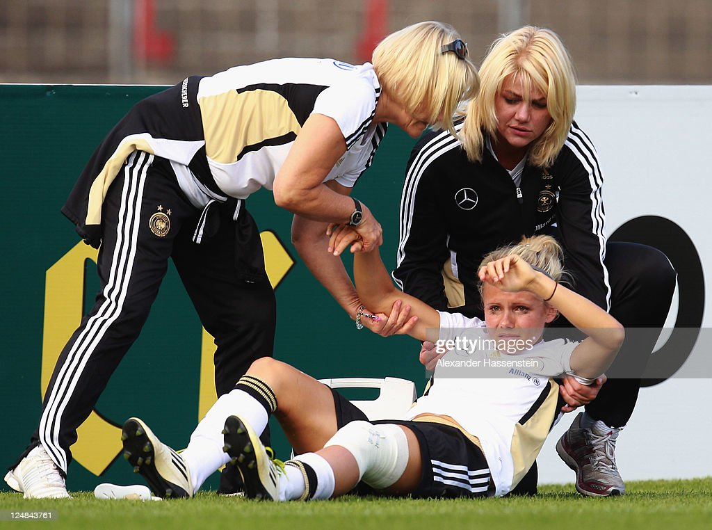 Julia Simic gets injured during a training session after the team presentation of the German Women's national team at Rosenau Stadium on September 13, 2011 in Augsburg, Germany.