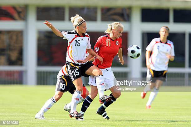 Julia Simic of Germany and June Tames of Norway fight for the ball during the Women's U19 European Championship match between Germany and Norway at...
