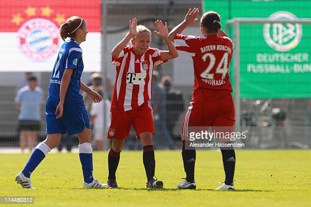 Julia Simic of Muenchen celebrates victory with her team mate Nadine Prohaska after winning the women Bundesliga Cup 2011 final match between FC...