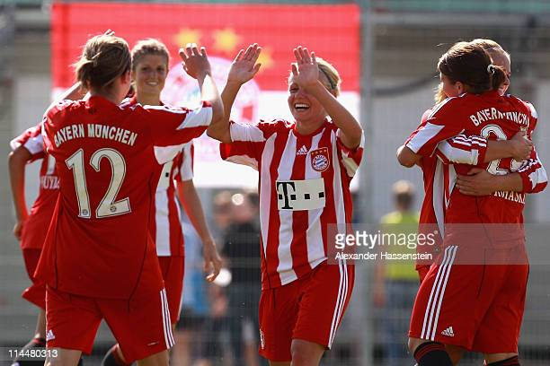 Julia Simic of Muenchen celebrates victory with her team mates after winning the women Bundesliga Cup 2011 final match between FC Bayern Muenchen and...