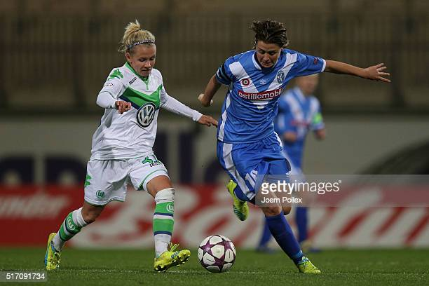 Julia Simic of Wolfsburg and Cristiana Girelli of Brescia compete for the ball during the UEFA Women's Champions League match between VfL Wolfsburg...