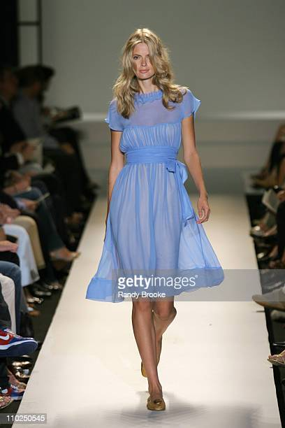 Julia Stegner wearing Kenneth Cole Spring 2006 during Olympus Fashion Week Spring 2006 Kenneth Cole Runway at Bryant Park in New York City New York...