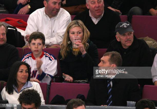 Julia Stiles with family during Celebrities Attend Philadelphia Flyers vs New York Rangers Game March 21 2007 at Madison Square Garden in New York...