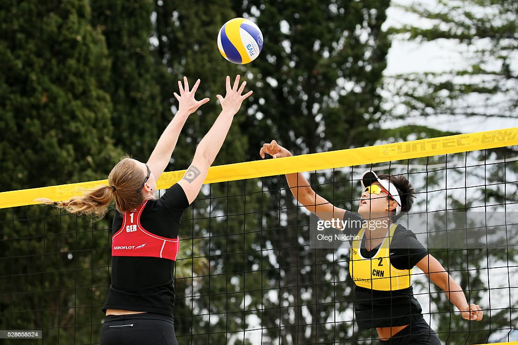 Julia Sude (left) of Germany and Xinyi XIA of China duel at the net during day 4 of FIVB Sochi Open presented by VTB on May 6, 2016 in Sochi, Russia.