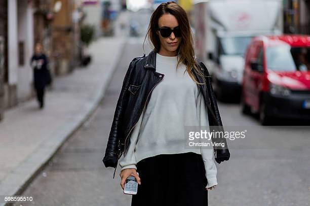 Julia Toivola wearing black cropped pants a white sweater jumper and black leather jacket on September 1 2016 in Stockholm Sweden
