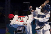 Julia Vasconcelos of Brazil competes with Joyce Baaren of Netherland during a Women's 80 kg combat of WTF World Taekwondo Championships 2013 at the...