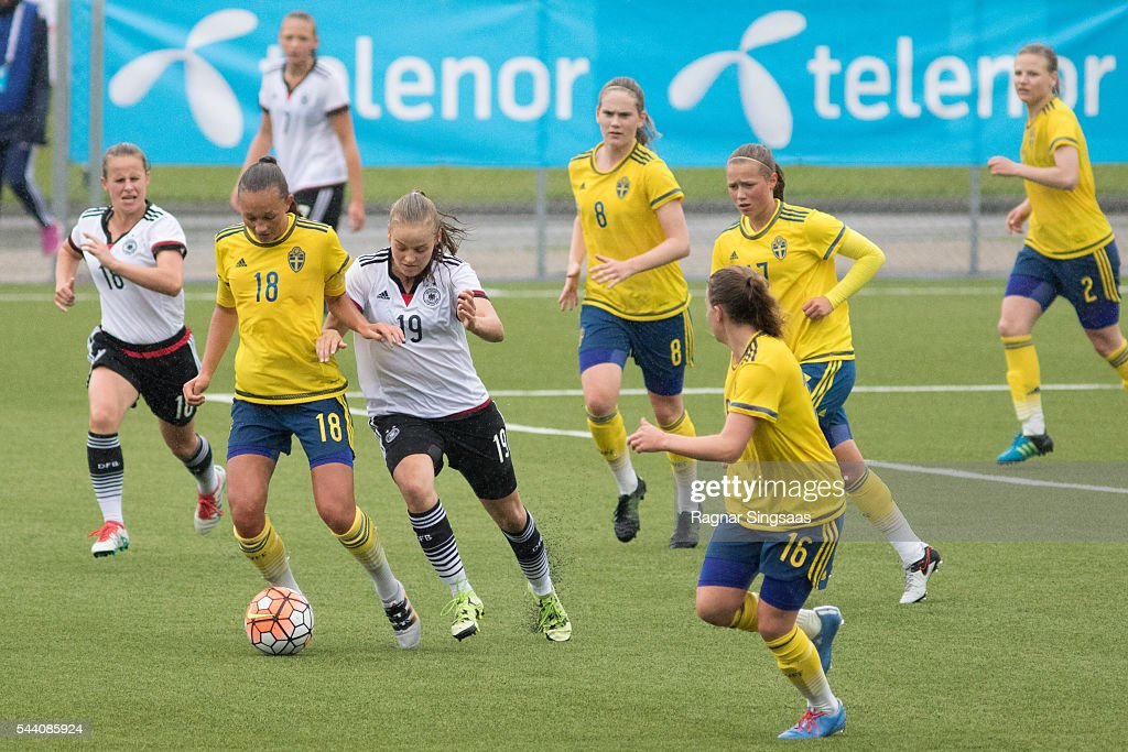 Julia Welin of Sweden and Lena Uebach of Germany compete for the ball during the Nordic Cup game between U16 Girl's Germany v U16 Girl's Sweden on July 1, 2016 in Rade, Norway.